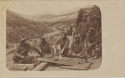Bulgarian machine-gunners laying out ammunition belts on the Salonica Front.