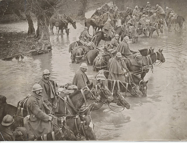 Mounted reserves fording a stream on their way to Verdun, a photo from the archives of the Chicago Sun-Times and Chicago Daily News. The back of the photo is stamped Oct — 3 1916. A hand-written note indicates it would cover two columns on the home page.
