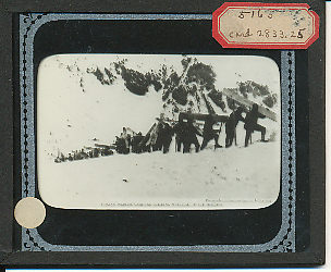 Glass slide of Italian soldiers carrying building material up a mountainside in the Dolomite Alps.