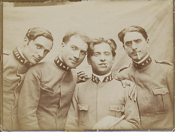 Photograph of four First World War Italian soldiers. The one on the far right wears a monocle.