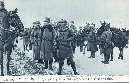 General Karl Freiherr von Pflanzer-Baltin in the snowy field, officers, soldiers with horses at the ready, and a column of soldiers behind him.