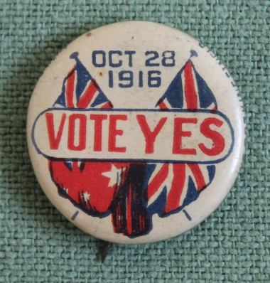 Vote Yes pin for Australian conscription, October 28, 1916, with the flags of Australia and Great Britain. A tin badge or tie-back pin in support of the Australian referendum on conscription, October 28, 1916. Australia voted no on this occasion and again, by a wider margin, in December, 1917.