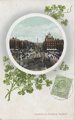 A view of Sackville Street (now O'Connell), Dublin, Ireland and the bridge over the Liffey River framed by a spray of shamrocks. The card was postmarked Dublin, August 30, 1911.
