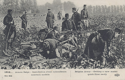 Belgian soldiers preparing a Hotchkiss machine gun position in a field. A line of troops is visible in the background. Like other attackers throughout the war, the Germans suffered heavy losses attacking positions defended by machine guns.