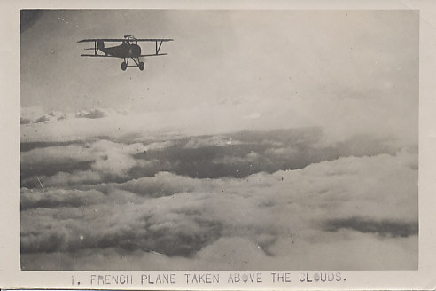 A French Nieuport fighter plane in flight, possibly a Nieuport 17, but possibly another model up to the Nieuport 27, with machine guns both above the upper wing, and along the fuselage.
