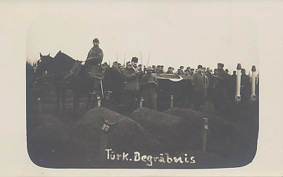 A Turkish funeral with Turkish and German soldiers and officers attending and praying.