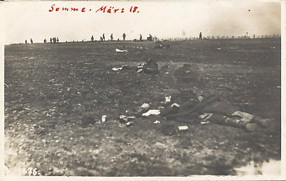 Living and dead soldiers on the Somme in March, 1918. Operation Michael, the German spring offensive 1918 began on March 21. Men and barbed wire line the horizon; dead soldiers lie in the foreground.