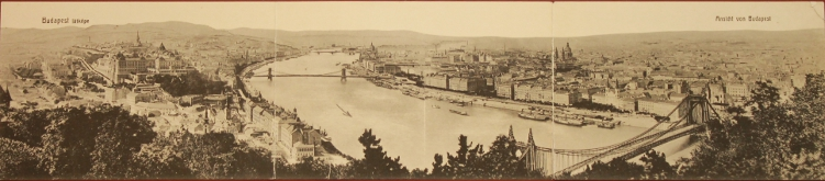 Panoramic view of Budapest on the Danube River. The hill(s) of Buda are on the left, and Pest is on the right. Prominent buildings include Parliament and St. Stephen's Cathedral.