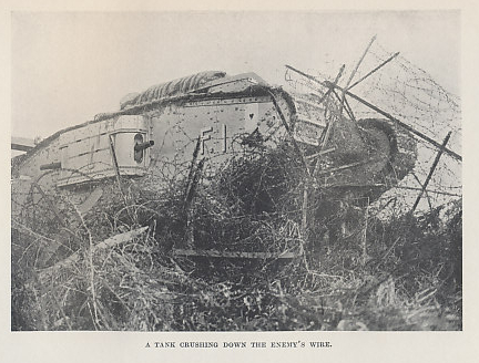 A British Mark IV (?) tank crushing barb wire defenses. From 'The Tank Corps' by Major Clough Williams-Ellis & A. Williams-Ellis.