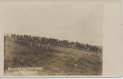Photograph of Russian troops on the front line taken May 15, 1917, after the Russian Revolution, from the German or Austro-Hungarian line. A barbed wire emplacement separates the photographer from the Russians. The Russian front was mostly quiet between the revolution in March and a Russian offensive begun July 1.