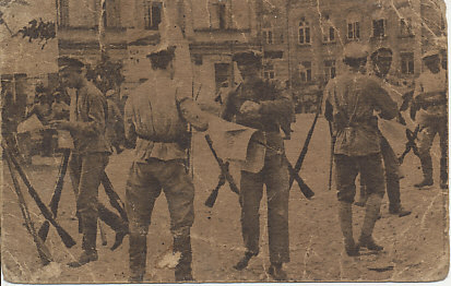 A Bulgarian postcard of Red Army soldiers at rest, with rifles stacked, and reading newspapers or leaflets.