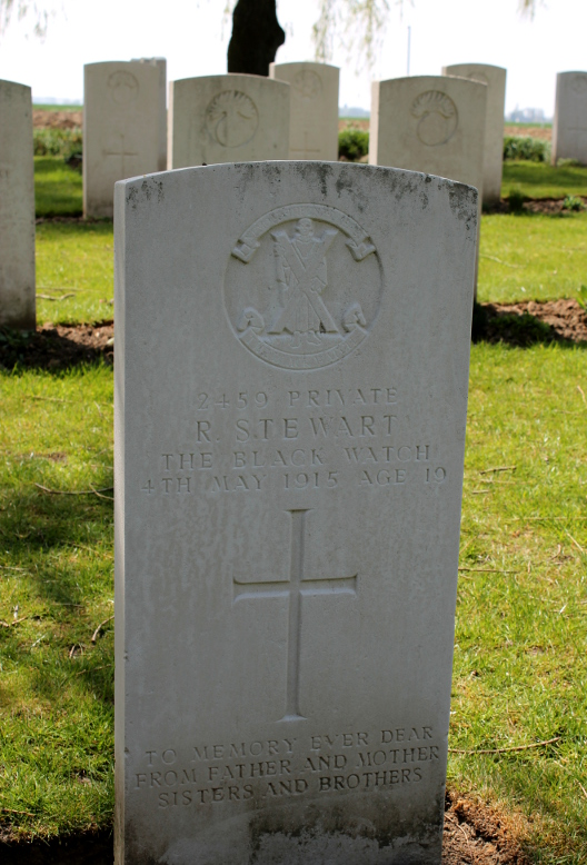 The headstone of Private R. Stewart, of the Black Watch, who died May 4, 1915, age 19, and is buried in Le Trou Aid Post Cemetery in Fleurbaix, Pas-de-Calais, France. It is inscribed