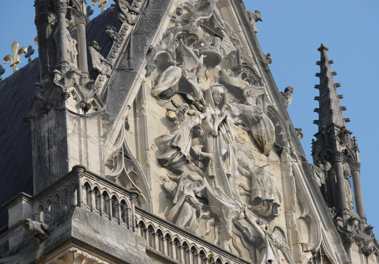 The Assumption of the Virgin Mary, Rheims Cathedral. German artillery first shelled the magnificent Cathedral of Rheims on September 19, 1914 igniting scaffolding that covered the north tower, and beginning a fire that spread to other woodwork within the building. The building was intermittently shelled throughout the war, particularly in the spring of 1917 when it was struck with 70 high-caliber shells.