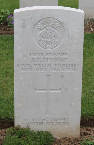 Headstone of Private A.C. Thomas of the Royal Welch Fusiliers in Delville Wood Cemetery, Longueval, France. Thomas died July 20, 1916, aged 23.
