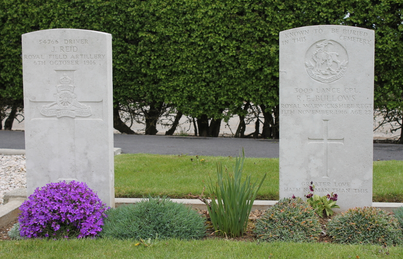 Headstones from Martinpuich Cemetery, Martinpuich, France: for J. Reid of the Royal Field Artillery, died October 6, 1916, and R.E. Bullows of the Royal Warwickshire Regiment, died November 11, 1916. Martinpuich was in the Somme sector.