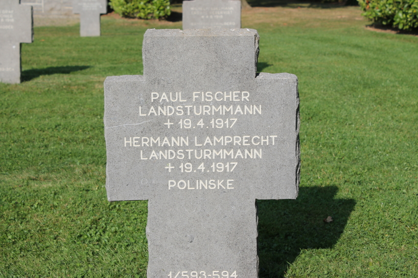 Headstone in the German Cemetery at Cerny-en-Laonnois for the graves of the Landsturm infantrymen Paul Fischer and Hermann Lamprecht, both died April 19, 1917 during the Second Battle of the Aisne. The grave contains the remains of 'Polinske', dead with no further information. The %i1%Landsturm%i0% were reserve units, typically of older men.