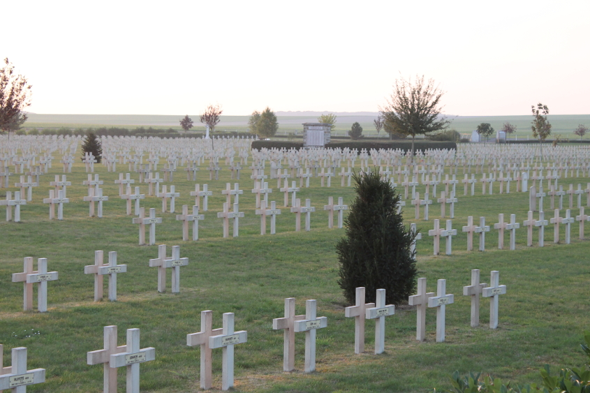Headstones at La Nécropole Nationale de Pontavert. The cemetery contains the remains of 6,815 soldiers, 67 of them British, 54 Russian, and the remainder French. Of the total, 1,364 are entombed in the ossuary.