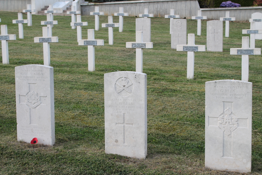 Three headstones at the Necropole Craonelle, a French military cemetery, of British soldiers who died May 27, 1918, most likely killed in the German Aisne offensive that began that day. From left to right the headstones are those of Norman Gibson, East Yorkshire Regiment, age 18; C. G. Sills, Machine Gun Corps; and G. Rees, Yorkshire Regiment. Webmatters.net includes these men and two others noting that, 'These men were caught up the whirlwind of Operation Blücher launched by the Germans on the morning of 27th May 1918. They were part of the 150th Brigade of 50th Division holding the Plateau de Californie and Craonne.'