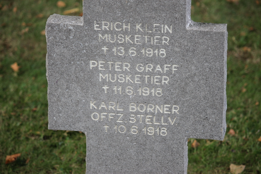 Shared headstone of Erich Klein, infantryman, died June 13, 1918, Peter Graff, infantryman, died June 11, 1918, and Karl Börner, Deputy Officer, died June 10, 1918, in the Belleau German Cemetery, Belleau, France. They may have been killed during the weeks-long American attack to seize Belleau Wood, begun on June 6.