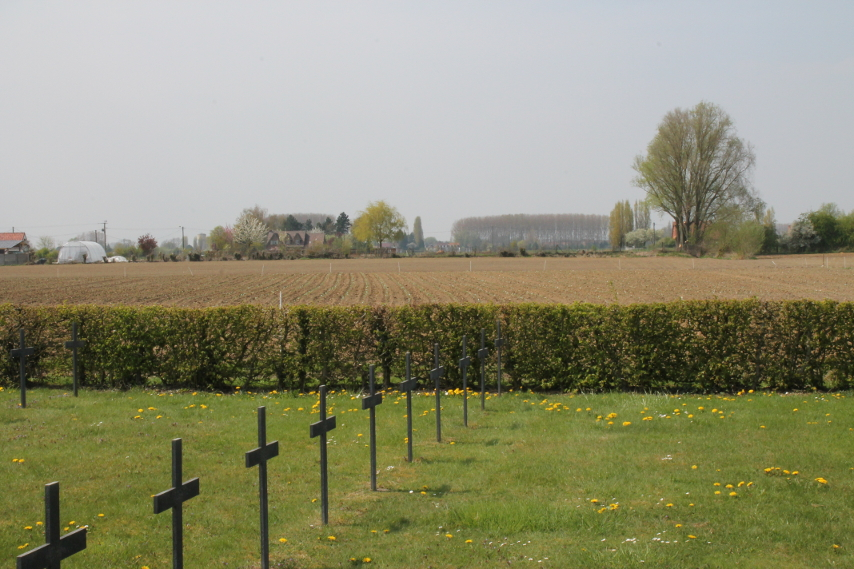 Metal grave markers at the Laventie German Military Cemetery, Laventie, France. A plowed field is in the background.