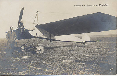 Anton Fokker with his new monoplane. Sanke card 329 of the Fokker Eindecker (E.I?). Although the rotary engine is clearly visible, the machine guns(? one?) are not. Fokker introduced the synchronized machine gun with the Eindecker.