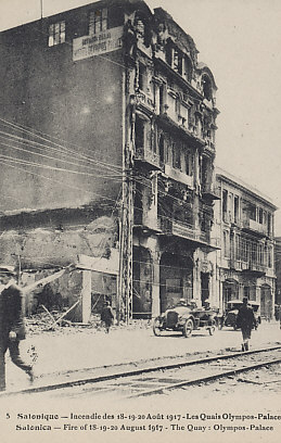 Salonica (Thessaloniki), a base of Allied operations in the Balkans, suffered enormous damage in the first of August 18, 19, and 20, 1917. In the postcard, the Quay: Olympos-Palace.