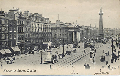Sackville Street in Dublin, Ireland, looking to the northwest. In the foreground is the monument to Daniel O'Connell, in the distance, that to Admiral Nelson. Between them, its portico prominent, is the General Post Office, the rebel headquarters in the 1916 Easter Rising. On the back is a message dated October 1, 1906, and the card was postmarked the same day.