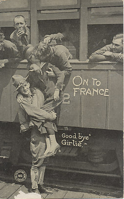 Goodbye Girlie! On to France. An American soldier gives a woman a boost so she can kiss a departing soldier. A postcard from the Chicago Daily News, G. J. Kavanaugh War Postal Card Department.