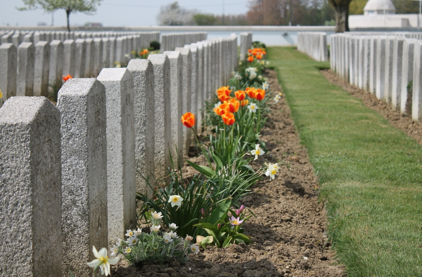 Headstones in the Portuguese Cemetery in Neuve Chapelle, France. Portugal joined the Entente Allies in 1917. They were on the front line in %+%Event%m%97%n%Operation Georgette%-%, the German Lys Offensive, the second German drive of 1918. The Cemetery is across a field from the Indian Memorial visible in the background. Nearby is the Laventie German Cemetery.